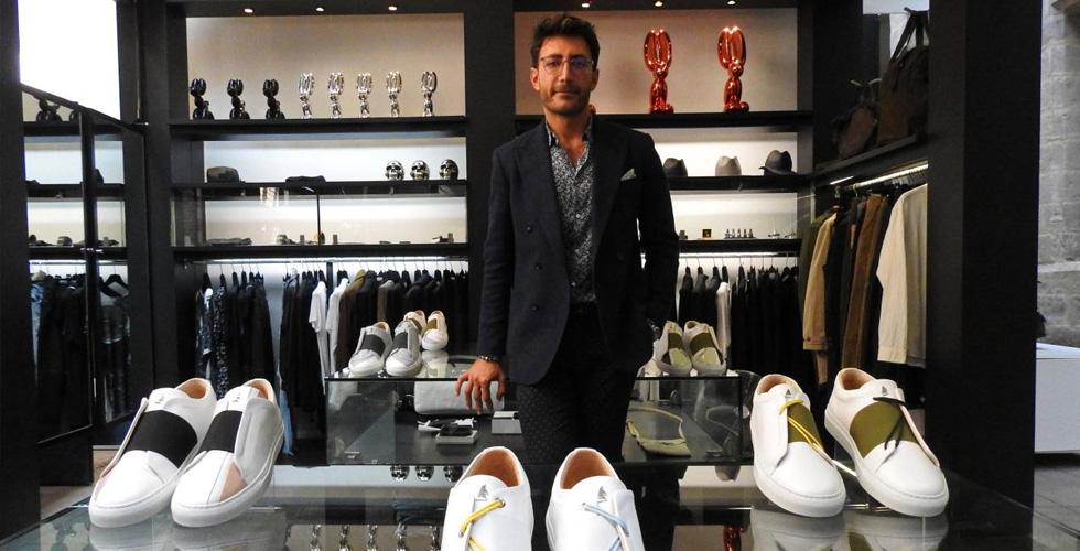 لاجئ سوري يمتلك ماركة أحذية رياضية فاخرة
