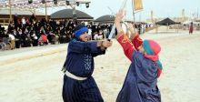 المبارزة بالسيوف في لياقة المتنافسين في سوق عكاظ
